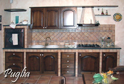 Cucina puglia realizzata in pietra lavica ceramizzata le - Rivestimento cucina in muratura ...